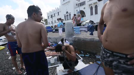 asylum seekers : KOS, GREECE - SEP 28, 2015: Unidentified war refugees wash up on the beach. Kos island is located just 4 kilometers from the Turkish coast, and many refugees come from Turkey in an inflatable boats.