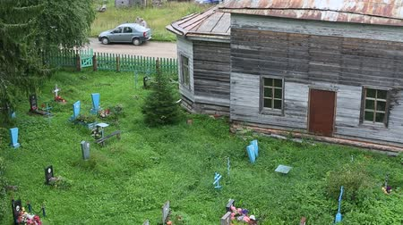 churchyard : SOGINICY, RUSSIA - JUL 30, 2016: The old cemetery near the Church of St. Nicholas built in 1696. A village Soginicy of Podporozhsky district of Leningrad region, was first mentioned in 1563.