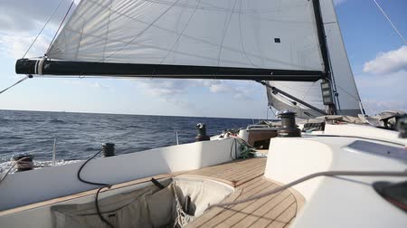 Sailing in the wind through the waves. Luxury yacht boat in race regatta.