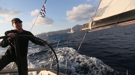MILOS, GREECE - SEP 26, 2016: Sailors participate in sailing regatta 16th Ellada Autumn 2016 among Greek island group in the Aegean Sea, in Cyclades and Saronic Gulf.