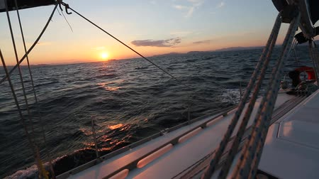 Beautiful sunset on a yacht sailing in the sea.