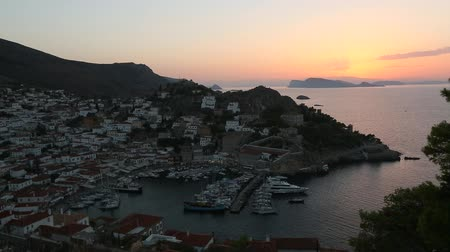 Top view twilight of Hydra island, Greece - city center and yaht marina after sunset. Stock Footage