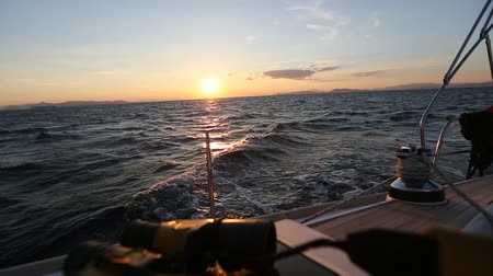 Sailing on the waves during a wonderful sunset. Travel.