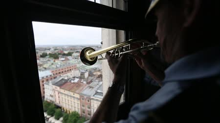 hymn : KRAKOW, POLAND - SEP 20, 2016: Heynal St. Marys dawn also known as the Cracovian Hymn played by a trumpeter from the highest tower of St. Marys Church in Krakow.