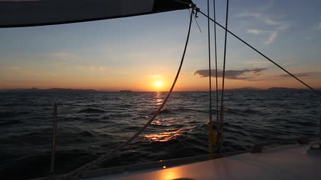 Amazing sunset at sea on a sailing yacht.