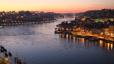 Night view of the Douro river and Ribeiro in Porto, Portugal.