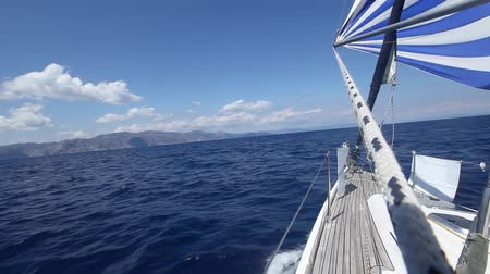 Sailing in the wind through the waves (HD) Sailing boat shot in full HD at the Mediteranean sea. Stock Footage