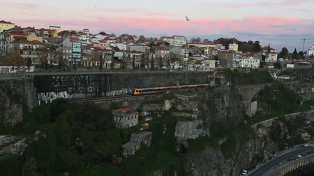Subway train passing in a tunnel. Twilight view on the bank of the Dora river in Porto, Portugal.