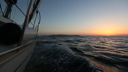 Sailing regatta in Greece, during sunset.