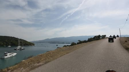 Riding ATV on serpentine roads of Poros island, Greece. Stock Footage