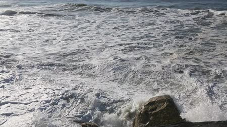 Ocean surf on a rocky coast. Stock Footage