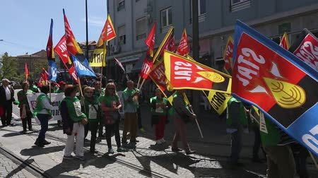 associados : PORTO, PORTUGAL - MAY 1, 2017: During celebration of May Day in the city centre. General Confederation of Portuguese workers, traditionally associated with the Communist party, has 800.000 members.