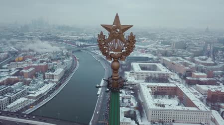 komünizm : Aerial footage of Stalins USSR skyscrapers star. Drone views of the Kremlin, Red Square, Moscow River and other sights. Winter. Stok Video