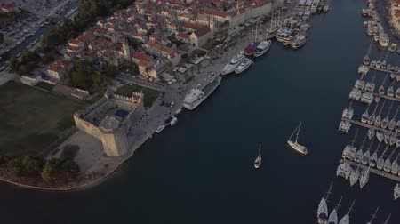 balcani : Aerial footage of Trogir port in Croatia at sunset. White boats standing and floating on the sea.