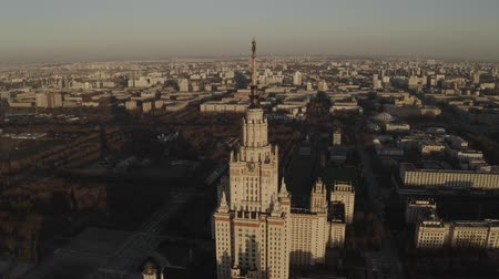 ímã : Aerial footage of stalin building Moscow State University in spring sunny day, on sunset. Russia. Gray scale. Communistic star