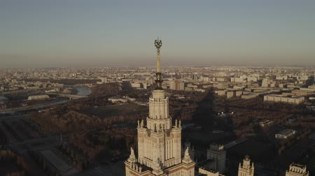 d day : Aerial footage of stalin building Moscow State University in spring sunny day, on sunset. Russia. Gray scale. Communistic star