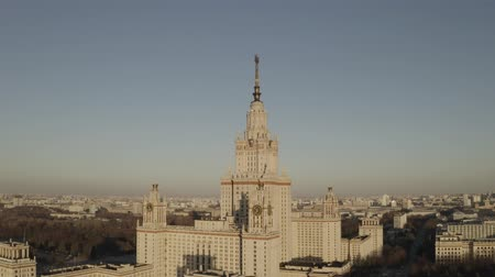 comunismo : Aerial footage of stalin building Moscow State University in spring sunny day, on sunset. Russia. Gray scale. Communistic star