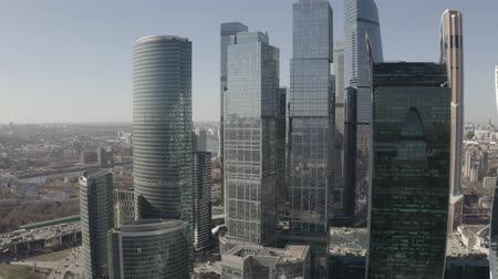 otoyol : Aerial view on Moscow city skyscrapers and Moscow river. Sunny, blue sky, spring. Cars driving on the motorway. Stok Video