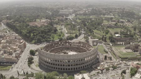 flavian : Aerial footage of Coliseum from drone, Rome, Italy. Drone flying around the ancient amphitheatre.