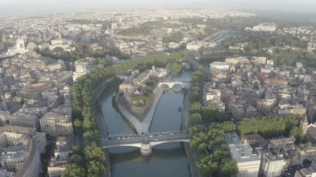 flavian : Aerial footage of Tiberina island in Tiber river, Rome, Italy. From drone. Birds eye view. Sunny day.