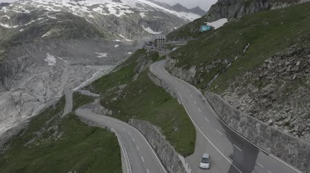 enrolamento : Aerial view of Hotel Belvedere and Furka Pass winding Road in Switzerland, Beautiful Swiss nature, mountains with snow, and Rhone Glacier.