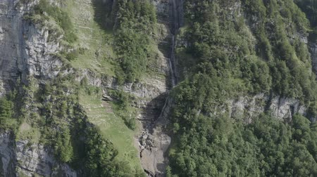 hegytömb : Aerial view of waterfalls in rocky mountains, Klontalersee lake Glarus Kanton, Switzerland.
