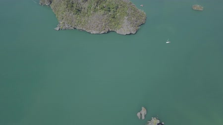 kilim : Aerial footage of island in sea. Boat float near the island. Park Kilim Geforest, Langkawi, Malaysia. Nature from drone.