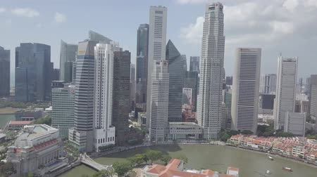 otoyol : Aerial view of Singapore Skyline Skyscrapers high buildings in Downtown Core River, green trees, road with cars. Stok Video