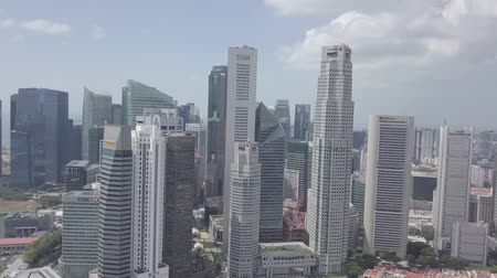 colonial : Aerial view of Singapore Skyline Skyscrapers high buildings in Downtown Core River, green trees, road with cars. Stock Footage