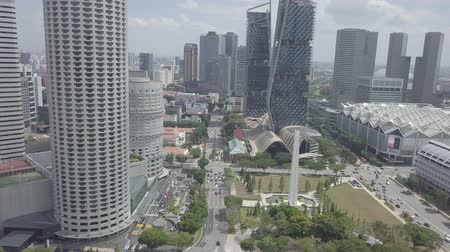 autobahn : Aerial view of Singapore Skyline Skyscrapers high buildings in Downtown Core River, green trees, road with cars. Stock Footage