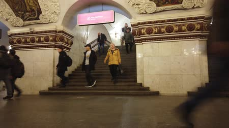 搭乗 : Moscow, Russia - December 16, 2019: Time-lapse of people going up and down the stairs, waiting trains and meeting at subway station platform in Moscow city, Russia. Public transport. 動画素材