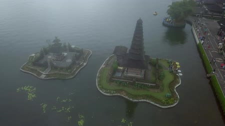 bratan : Aerial footage of Pura Ulun Danu water temple on lake Bratan in Bali, Indonesia.