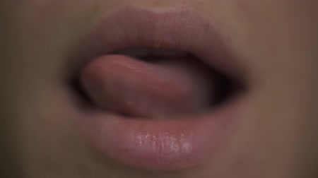 Macro Close up. Young woman open mouth and shows a pink tongue, smile, teeth. Face part. No make up natural beauty. Dostupné videozáznamy