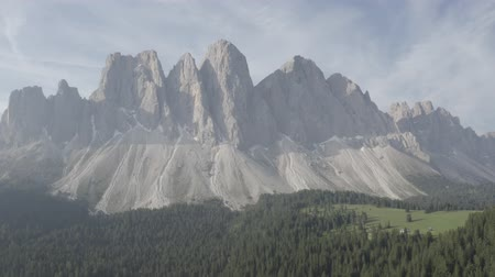 Aerial footage of Dolomites Alps mountains in summer. Geisler or Odle Dolomites Group. Furchetta mountain peak. Val Di Funes, Santa Maddalena, Italy Stok Video