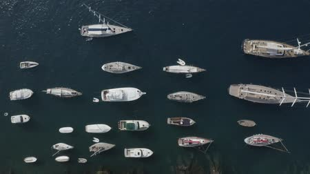 Aerial top down view of boats and yachts floating in the dark blue sea, Portofino bay, Liguria, Italy. Stok Video