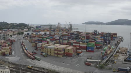 vorkheftruck : LA SPEZIA  ITALY - JULY 7, 2019: Aerial view of Container Freight Terminal of Spezia seaport. Freight containers in rows at the shipyard. Global Logistics Shipping industry. Export and Import transportation services. Stockvideo