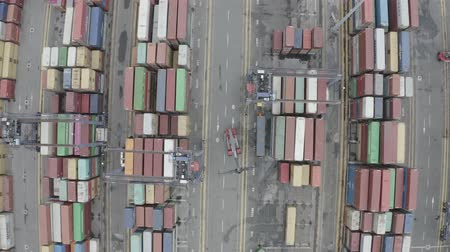 chariot elevateur : LA SPEZIA  ITALY - JULY 7, 2019: Aerial view of Container Freight Terminal of Spezia seaport. Freight containers in rows at the shipyard. Global Logistics Shipping industry. Export and Import transportation services. Vidéos Libres De Droits