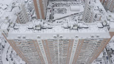 outskirts : Aerial footage of residential complex, sleeping area in winter. Modern large panel houses, high buildings. Novo-Peredelkino, Moscow, Russia.