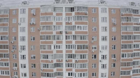 cityspace : Aerial pan down footage of windows of modern panel houses. Residential complex, sleeping area. Winter High building. Moscow, Russia.