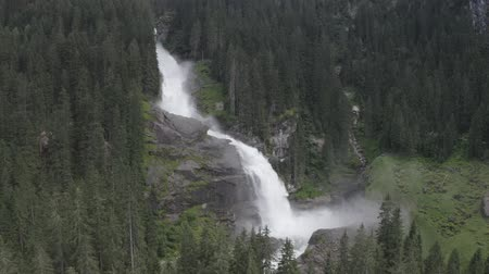cam : Aerial view of Krimml waterfall Cascades. Drone flight above strong water flow on rocks in spruce forest. Rainbow Tirol, Salzburg land, Austria.