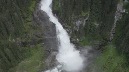 tirol : Aerial zoom out view of Krimml waterfall Cascades. Drone flight above strong water flow in spruce forest. Tirol, Salzburg land, Austria. Archivo de Video