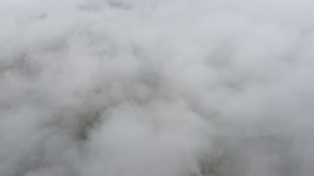 arborizado : Drone flies above clouds and road to Dolomites mountain peaks. Alps, South Tyrol, Italy. Cloudy weather. Summer Aerial view.