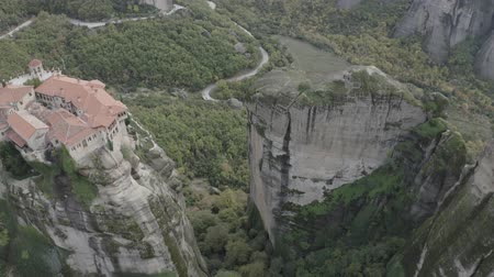kalambaka : Aerial view of Meteora with historical orthodox monasteries on top of meteors cliffs, Kalampaka, Greece. Drone flies over beautiful mountainous landscape with rocky cliffs.