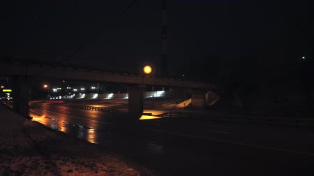 marnost : Moscow, Russia - JANUARY 10 2020: Time lapse. Moscow. Cars with headlights driving on the highway in the night, dark evening, Bridge over the road. Flashlights on street.