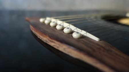 enstrümanlar : Bridge and strings of an acoustic guitar close-up camera motion on slider Stok Video