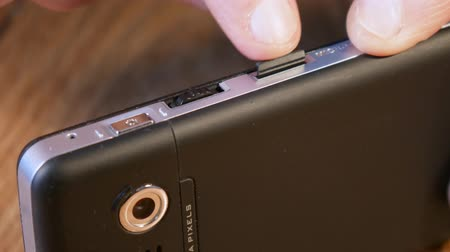 until : Insert the micro SD card in smartphone