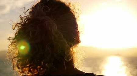 tüy : Girl with Curly Ginger Hair Enjoying Imressive Sunrise. Beautiful Sunlit Seascape. Thailand. Koh Samui. Slow Motion. Stok Video