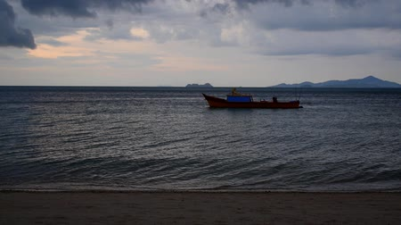 thicken : Anchored traditional thai fishing boat at dawn. Gulf of Siam, Thailand, Koh Samui Stock Footage