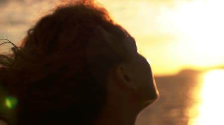 olhares : Close up Portrait of Young Beautiful Curly Woman in Sunset Light Sailing on the Ship. Slow Motion.