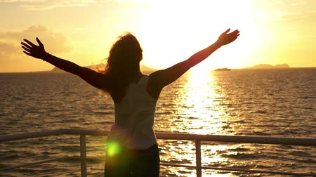 motivasyonel : Motivational, Uplifting Concept of Freedom, Happiness and Enjoyment. Young Woman Outstretching Arms at Impressive Sunset. Sea Cruise in Thailand. Slow Motion. Stok Video